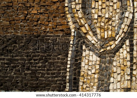 Wall decorated with mosaic tiles and colored bricks Picture taken without a vignette in bright colors.. A whimsical pattern. It can be used as the background or texture for any photo editor. - stock photo