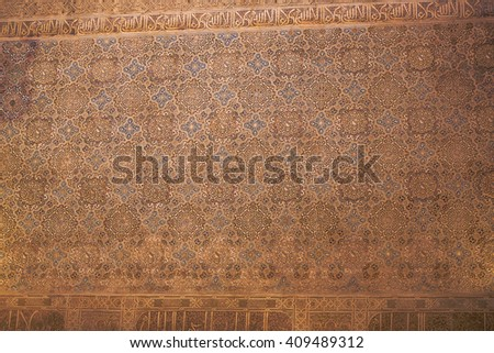 Wall detail of Alhambra in Granada. 600 years old arabic art. UNESCO heritage. South of Spain.  - stock photo