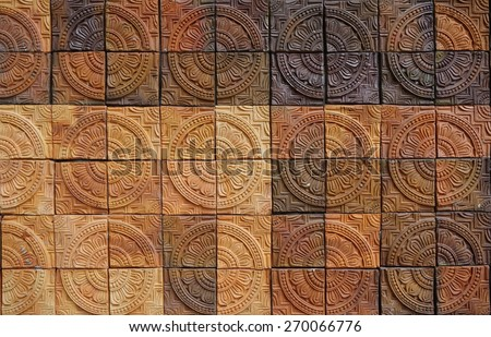 wall elevation detail of the flower shape decorative orange tone color terracotta tiles texture with tone