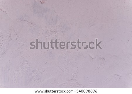 Wall fragment with attritions and cracks - stock photo