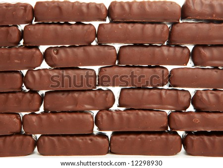 wall from chocolate sweets - stock photo