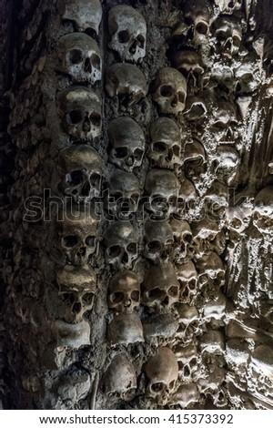 Wall full of skulls and bones - stock photo