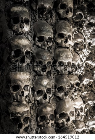 Wall full of skulls and bones in the bone chapel in Evora, Portugalhe bone chapel in Evora, Portugal - stock photo