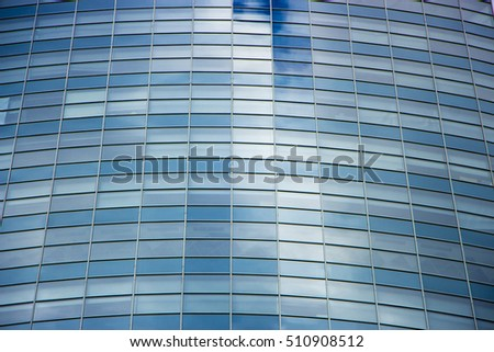 wall glass skyscraper with reflection of the sky at night. background