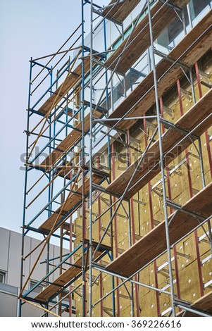 Wall insulation, mineral wool, composite panels cladding of buildings, resource conservation, scaffolding, carrying out aerial work, insulation of facades, building material, building facing work.