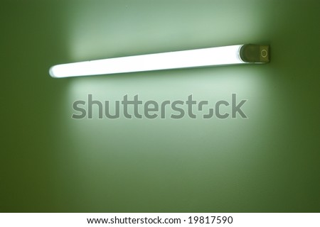 Wall lamp on the green wall - stock photo