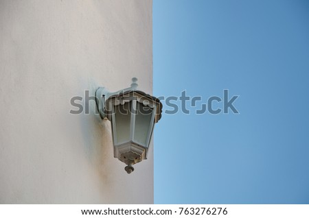 Wall light on sky background.