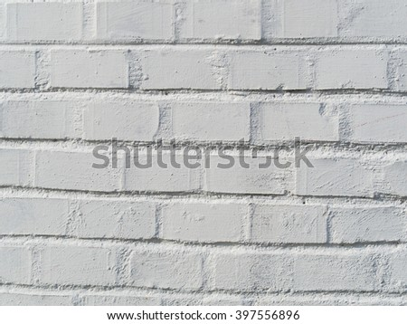 wall made of bricks painted in white creates a pattern - stock photo