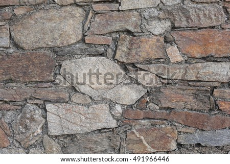 wall made of different types of stones