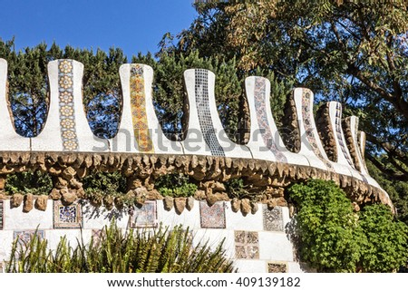 Wall Mosaic in garden, park Guell, Barcelona, Spain - stock photo