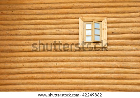 Wall of a new wooden house with window - stock photo