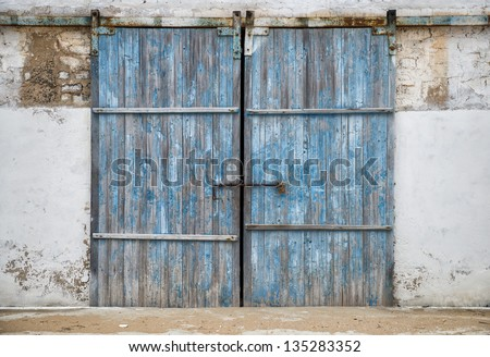 wall of ancient wooden barn with door - stock photo