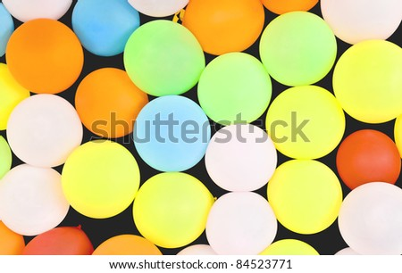 Wall of balloons ready for darts at the state fair. - stock photo