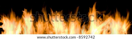 Wall of fire and flames over black background - stock photo