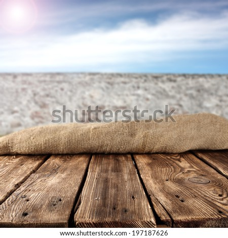 wall of gray and table of wood with summer sky  - stock photo