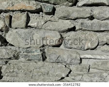 Wall of gray stones - stock photo