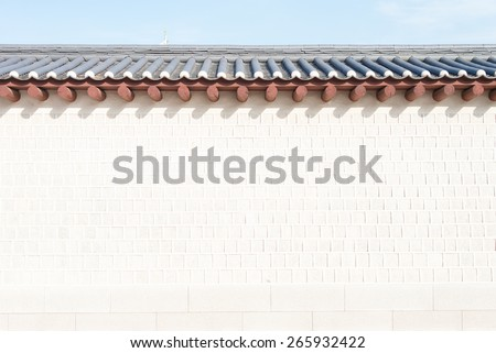 Wall of Gyeongbokgung ancient historic palace in Seoul, South Korea with clear sky in the sunny day  - stock photo