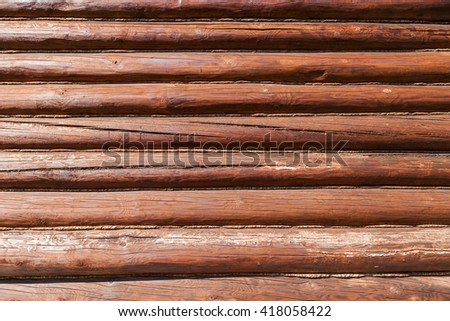 Wall of log house with cracks and tow. Folded in a row of timber frame - stock photo