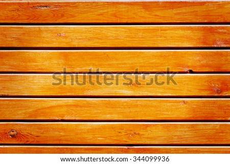 Wall of orange wooden planks - stock photo