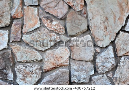 Wall of Rough Stones and Concrete Mortar Texture - stock photo