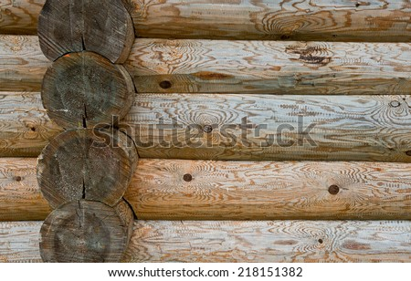 Wall of rural house of their fresh hewn logs of pine. Wooden background close up. - stock photo