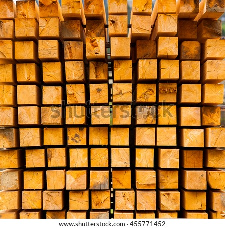 Wall of square log wood, wooden square section, wooden abstract background, pile of timber logs, wood square texture background