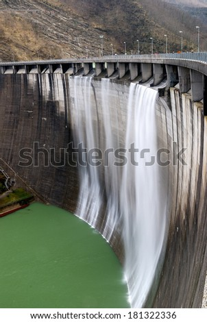 wall of the dam with overflow - stock photo