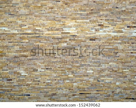 wall of the small natural stone tiles - stock photo