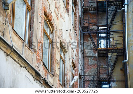 Wall old city building with stairs - stock photo