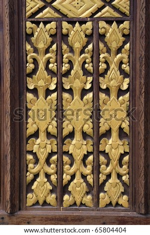 wall panel with yellow painted wood craft decoration - stock photo