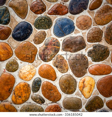 Wall round stone rock texture and seamless background - stock photo