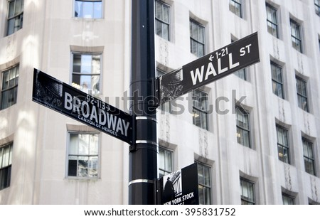 Wall St sign in lower Manhattan, New York City - stock photo