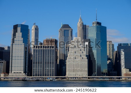 Wall Street and the lower Manhattan New York Financial District in late afternoon light - stock photo