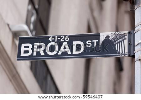 Wall Street road sign in the corner of New York Stock Exchange, Manhattan an icon of global investment, finance, trading - stock photo