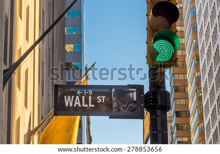 wall street sign and green light - stock photo