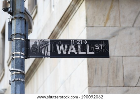 Wall Street sign in lower Manhattan New York - stock photo