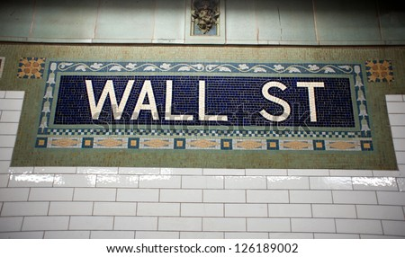 Wall street subway sign tile pattern in New York City Manhattan station. - stock photo