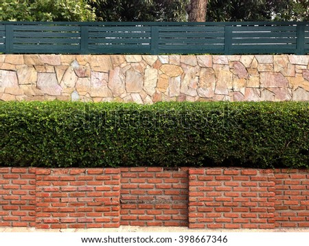 wall tiles/Ceramic tiles/ceramic tiles for wall or floor./brick wall /stone wall.Stone wall, steps and planter on colorful landscaped garden. - stock photo