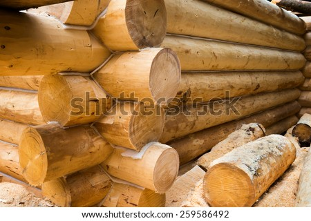Wall under construction of country wooden house. Details of the loghouse. - stock photo