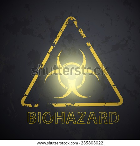 wall with a picture of the biohazard symbol - stock photo