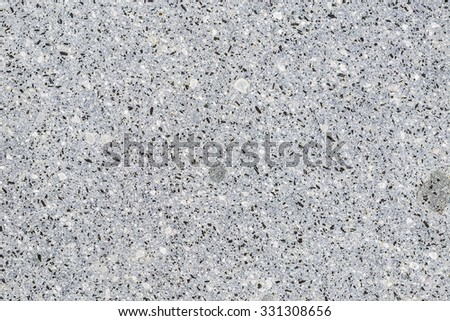 Wall with black stones here and there - stock photo