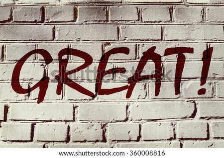 "Wall with graffiti that says ""Great!"" (abstract background, vintage, grunge - concept)"