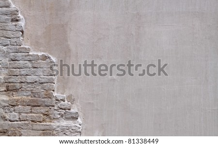 Wall with old bricks as background - stock photo