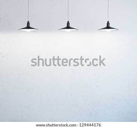 wall with three ceiling lamps - stock photo