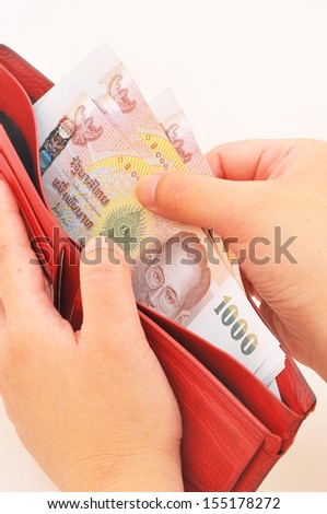 Wallet full of money, concept of wealth - stock photo