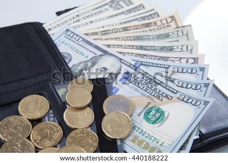 Wallet, money dollars, Euros and isolated on white background. - stock photo