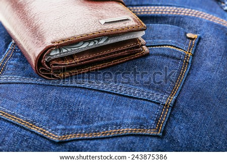 Wallet on the a pants pocket - stock photo