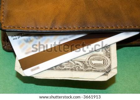 Wallet showing bills and debit card - stock photo