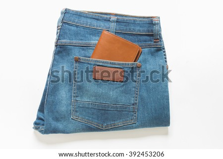 Wallet showing in back pocket of jeans.