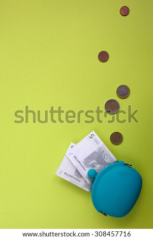 Wallet with euros falling out of it - stock photo